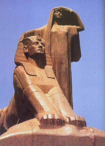 Egypt's Renaissance- a sculpture of a sphinx and a woman taking off her veil, the goddess Isis perhaps.